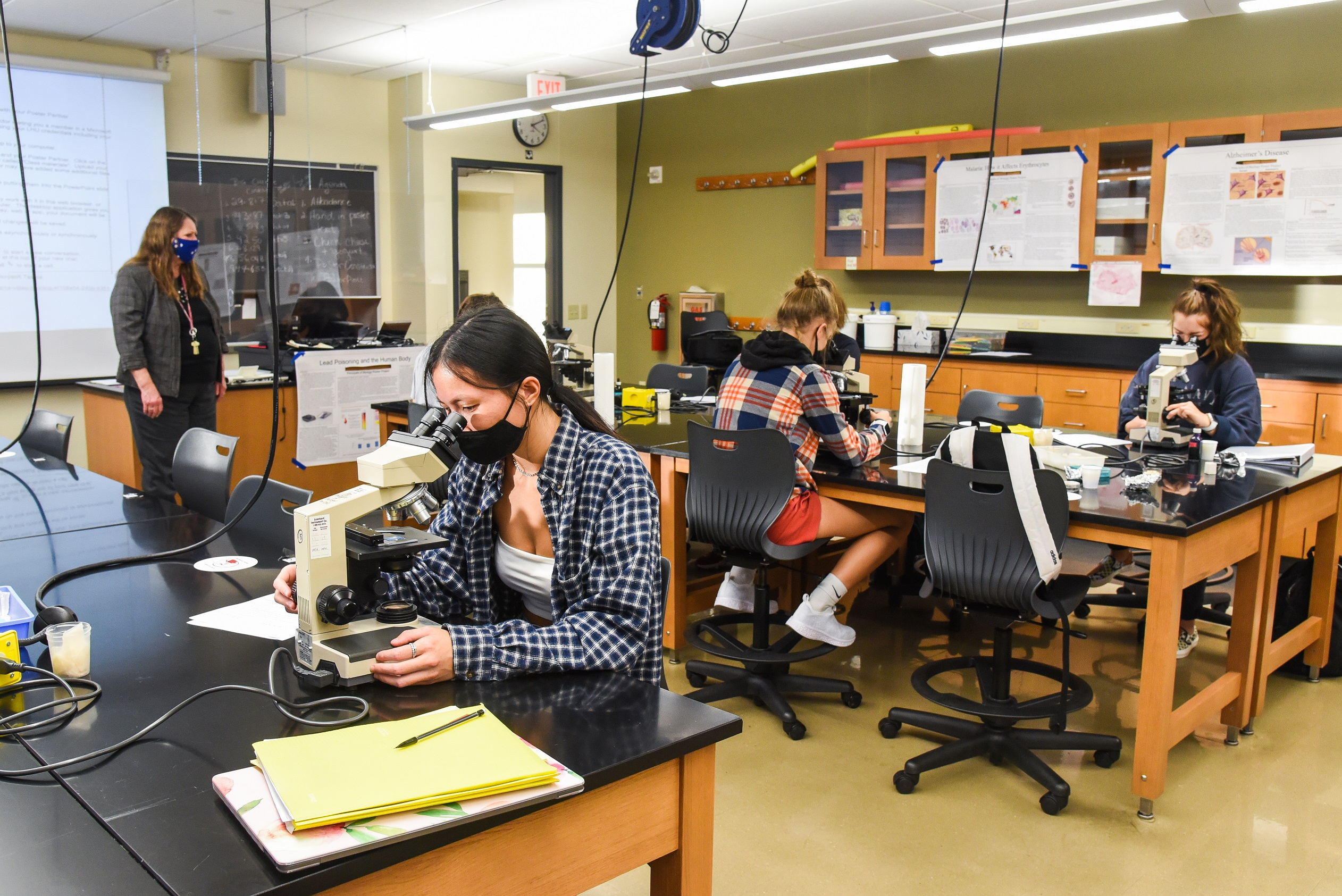 LHU students are shown during a lab, where social distancing is in place and facial coverings are required.