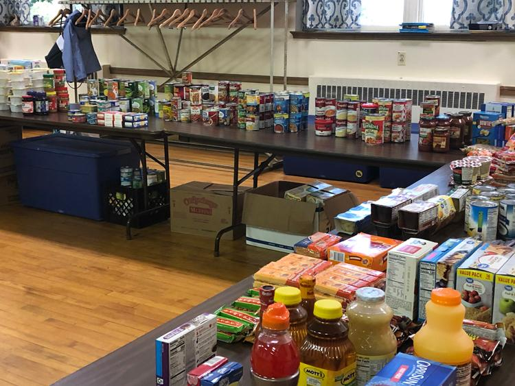 Food donations during the opening of the Haven Cupboard.