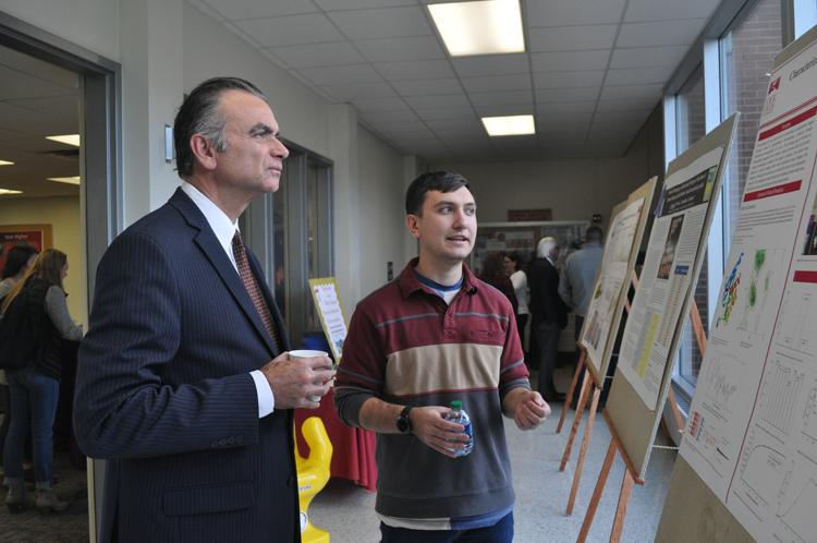 President Pignatello talking to a student during the event.