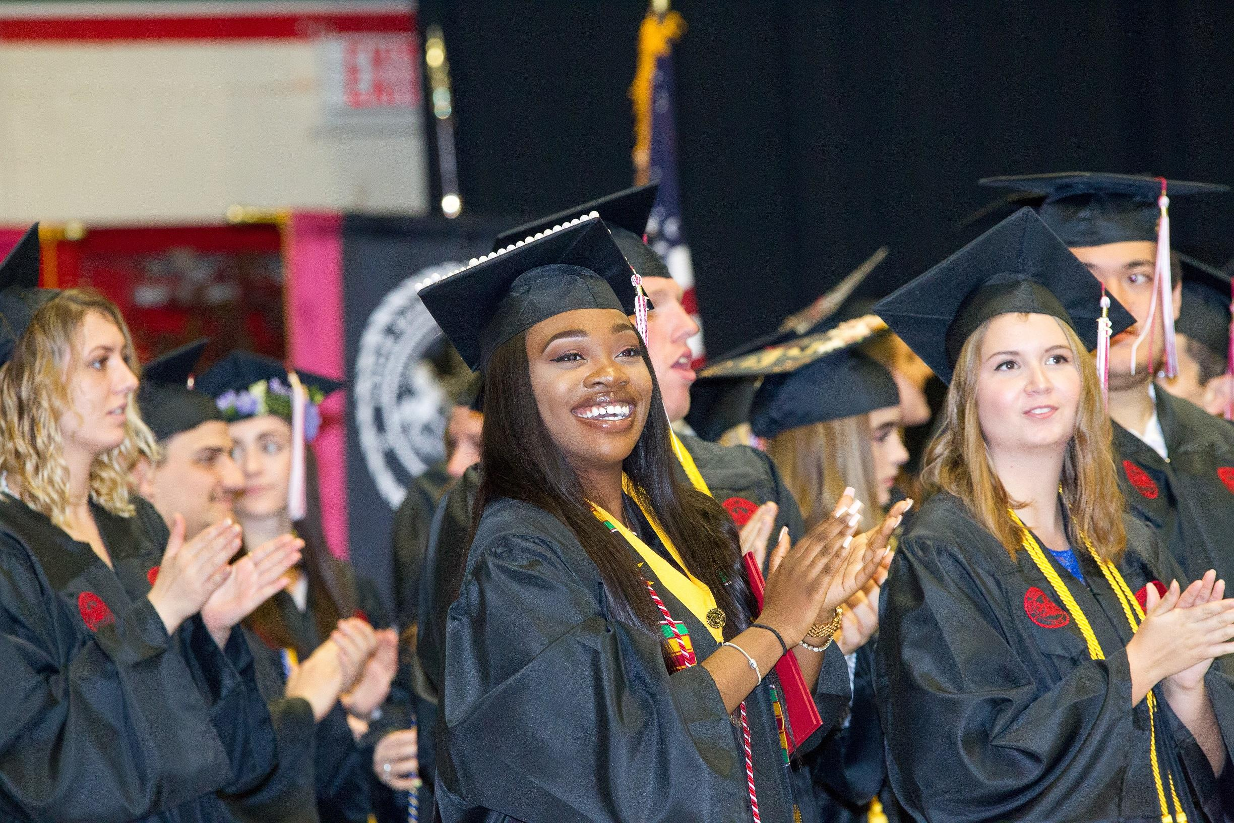 Recent Lock Haven University graduates turn to give their families applause during the undergraduate commencement ceremony on Saturday, May 12.