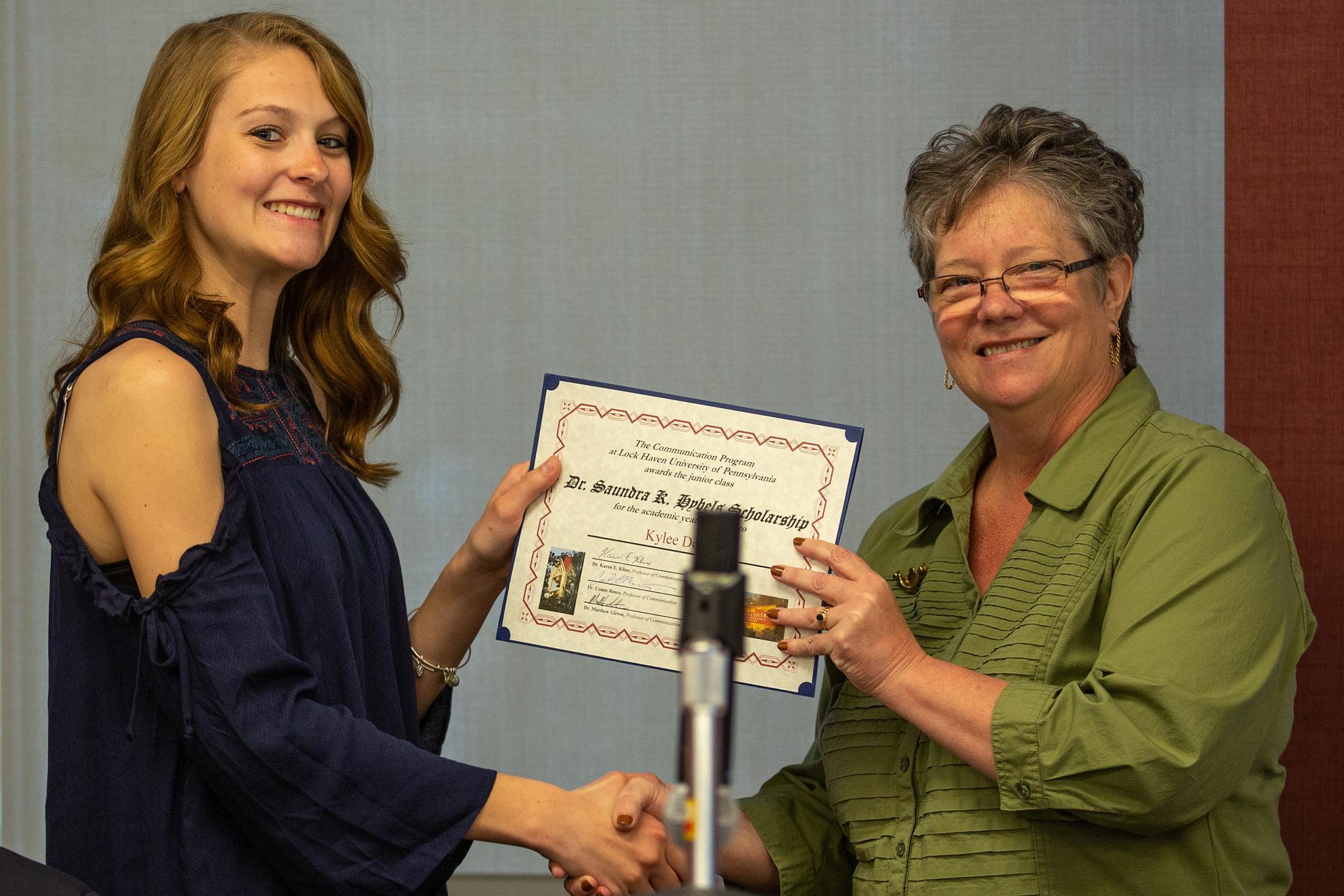 Kylee Doyle – Kylee Doyle, Dr. Saundra K. Hybels Scholarship junior award recipient, left, presented by Dr. Conne Reece, LHU professor.