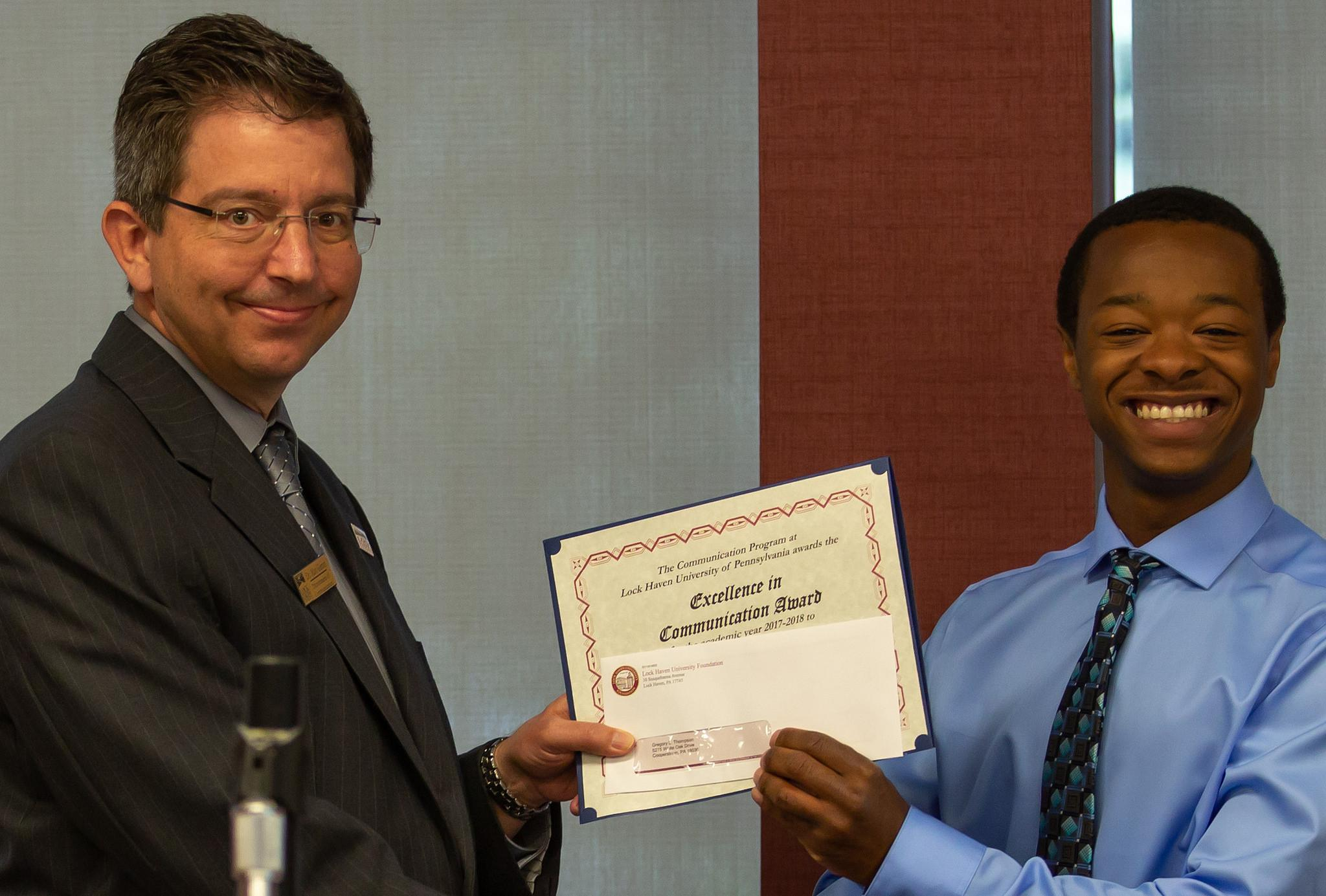 Gregory Thompson – Gregory Thompson, Excellence in Communication Award winner, right, presented by Dr. Matthew Girton, LHU professor.